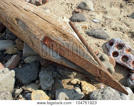 Wooden Pole With An Iron Spike On The Construction Site