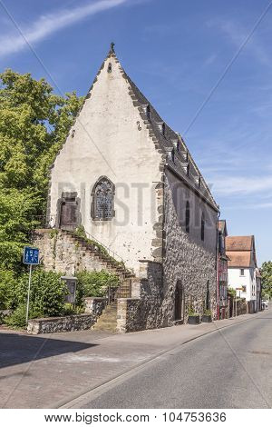 old timbered medieval houses in Butzbach Germany under blue sky poster