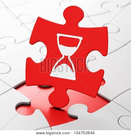 Time concept: Hourglass on puzzle background