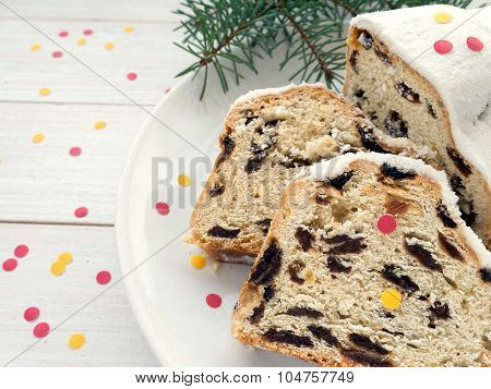 German Christmas Cake On The White Plate Sprinkled With Confetti
