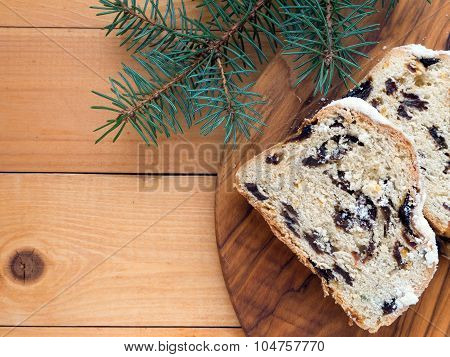 Stollen Cake On The Textured Wooden Board