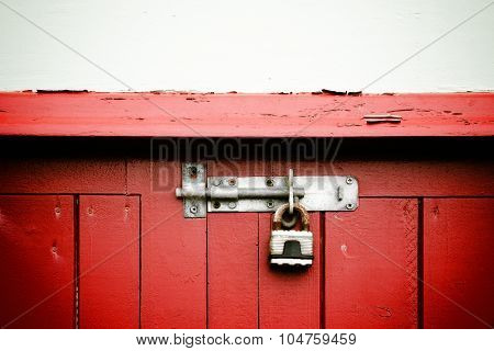 Old Rusty Padlock On Red