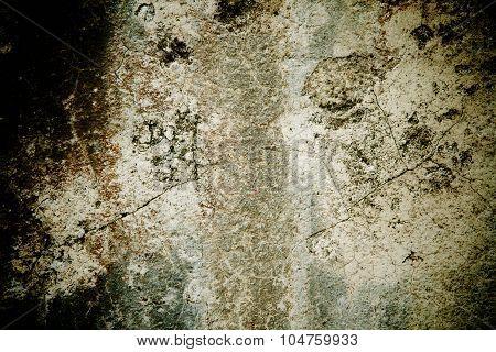 Rough dark stone background texture with cracks