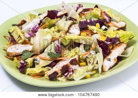 Chicken And Sweetcorn Salad On A Green Plate