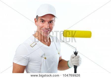 Painter man with painting roller. House renovation.