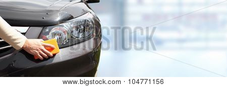 Car with wax and polish cloth over blue banner background.