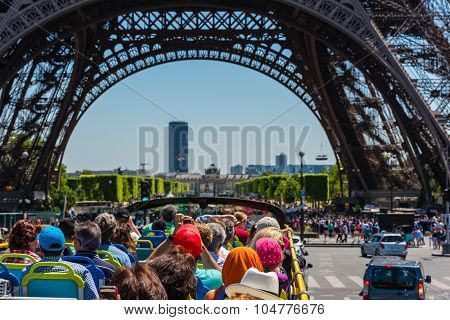 Tourists Enjoy Sightseeing Tour On A Bus In Paris