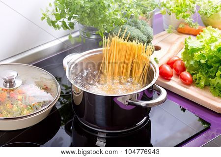 Pan Of Boiling Water With Spaghetti On The Cooker