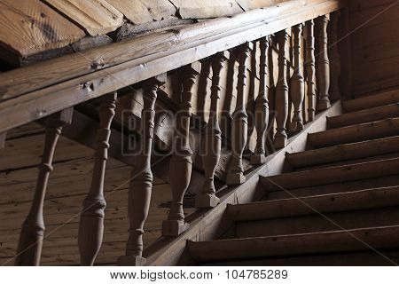 old wooden staircase railing