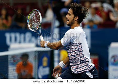 KUALA LUMPUR, MALAYSIA - OCTOBER 02, 2015: Spain's Feliciano Lopez volleys in the front court in his match at the Malaysian Open 2015 tennis tournament held at the Putra Stadium, Malaysia.
