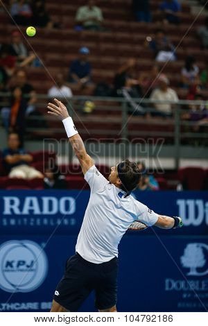 KUALA LUMPUR, MALAYSIA - OCTOBER 02, 2015: Spain's David Ferrer tosses the ball to serve in his match at the Malaysian Open 2015 tennis tournament held at the Putra Stadium, Malaysia.