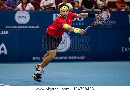 KUALA LUMPUR, MALAYSIA - OCTOBER 03, 2015: Spain's tennis player David Ferrer plays a backhand return at the 2015 Malaysian Open tennis tournament from Sep 26 - Oct 4, 2015 in Stadium Putra.