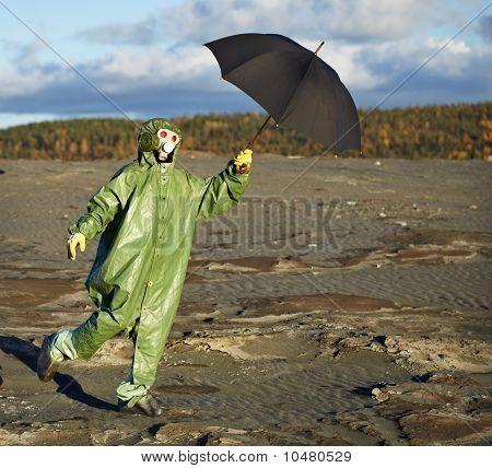 Person In Protective Scientific Overalls With Umbrella