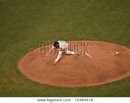 Giants Closer Brian Wilson Steps Forward As He Finishes A Throw Pitch