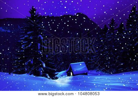 Winter in the mountains with little hut at christmas time