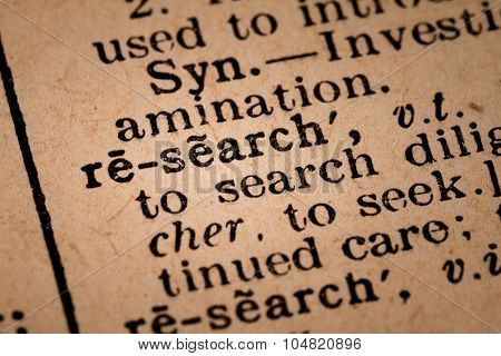 Close-up Of An Opened Dictionary Showing The Word Research