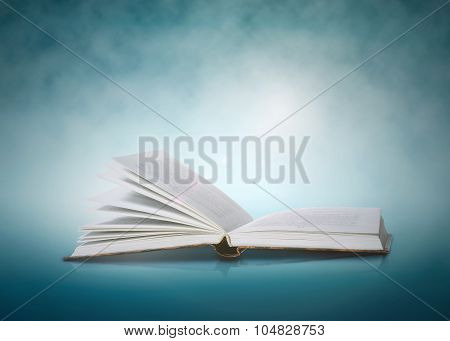 Open Book On A Blue Abstract Background