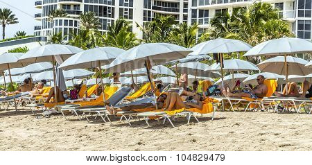 People Relax At Jade Beach In Sunny Isles Beach