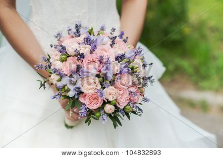 Wedding bouquet of lavender, roses and peonies.