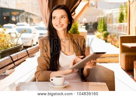 At Lunch Young Woman With Digitale Tablet And Cup Of Coffee In Cafe