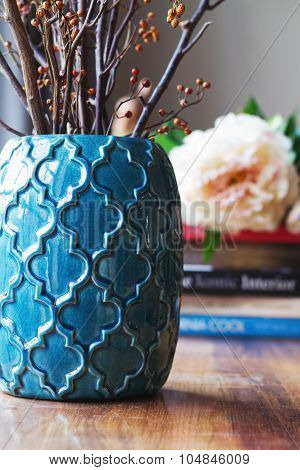 Close Up Of Teal Moroccan Vase With Sticks And Background Decor