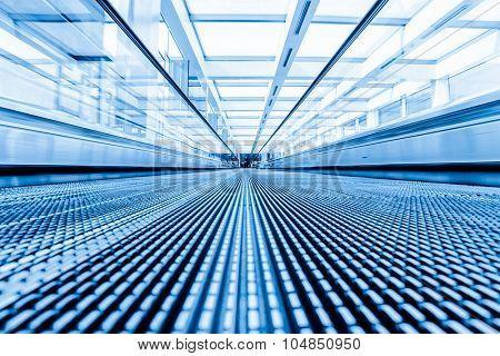 Close-up of moving escalator,motion blur