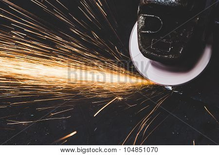 Working Cutting Rod With Saw Creating Sparks