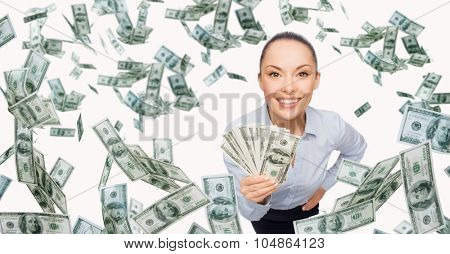 business, money, finance, people and banking concept - smiling businesswoman with heap of dollar cash money