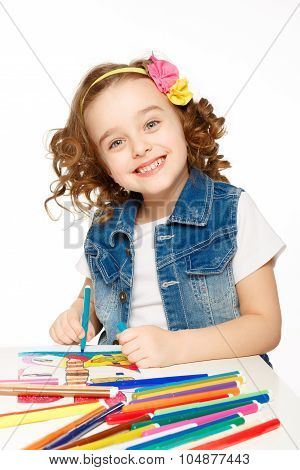 Cheerful little girl with felt-tip pen drawing in kindergarten. poster