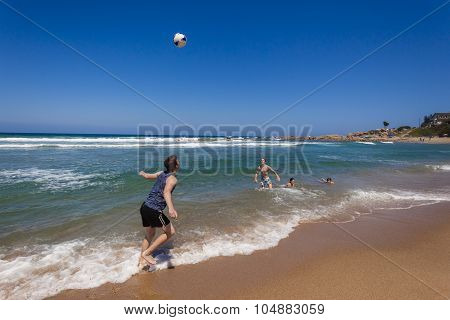 Teenagers Football Beach Ocean