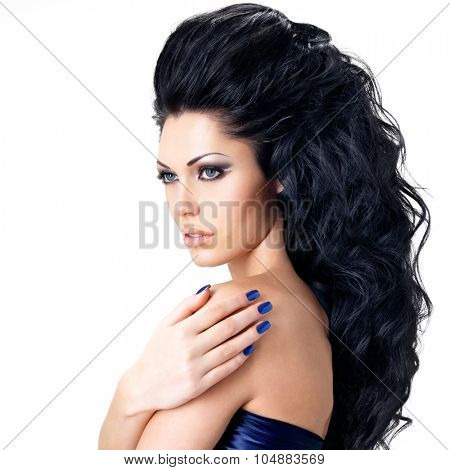 Portrait of brunette woman with beautiful long hairs. Fashion model with blue nails. - isolated on white