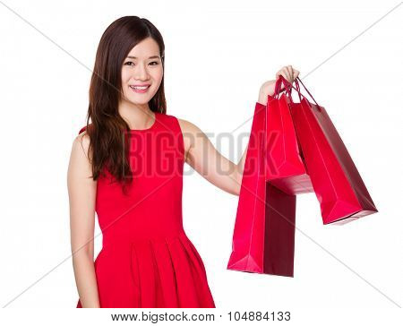 Woman with chinese traditonal costume hold with shopping bag