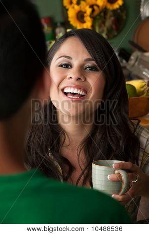 Beautiful Latina Woman With Cofee Or Tea And Male Companion