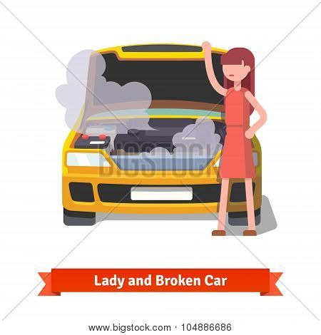 Woman looking under the hood of her broken car