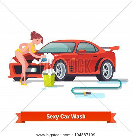 Sexy woman in swimsuit washing red sports car