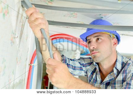 Electrician wiring a new building