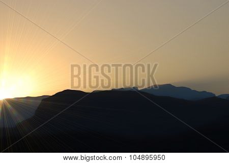 Mountain Range Silhouette In Sunset