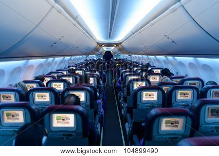 KUALA LUMPUR, MALAYSIA - MAY 12, 2014:  Malaysia Airlines Boeing 737 interior. Malaysia Airlines is the flag carrier of Malaysia and a member of the Oneworld airline alliance