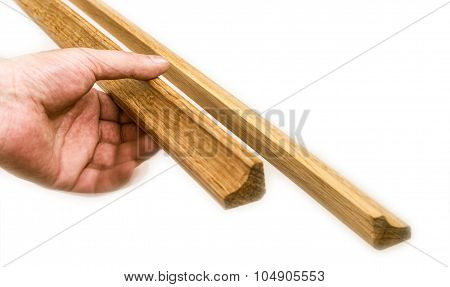 hand holding the baseboard, isolated on the white