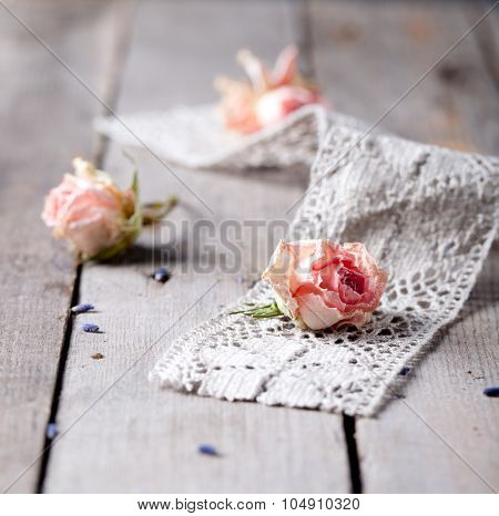 Dried roses with cage work on a wooden surface