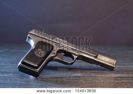 Pistol On Dark