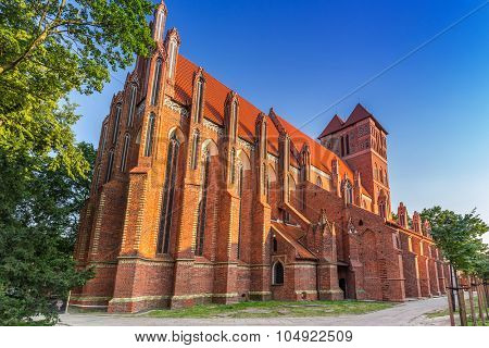 TORUN, POLAND - AUG 9, 2015: Architecture of historical St. Jacobs church in Torun, Poland. Torun is one of the oldest cities in Poland and the birthplace of the astronomer Nicolaus Copernicus.