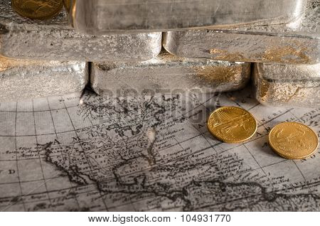 Silver Bars With Gold Eagle Coins On Map