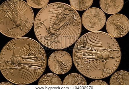 United States Gold Eagle Coins (1 & .1 Ounces) On Black Background