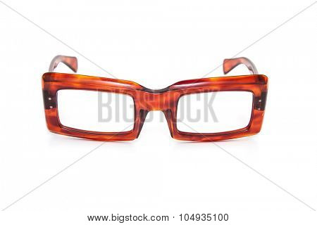 Old fashioned horn-rimmed specs. All on white background.