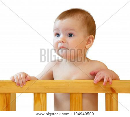 Sad Half-year-old Baby Holding The Side Cot