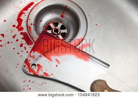 blood and cleaver in the sink