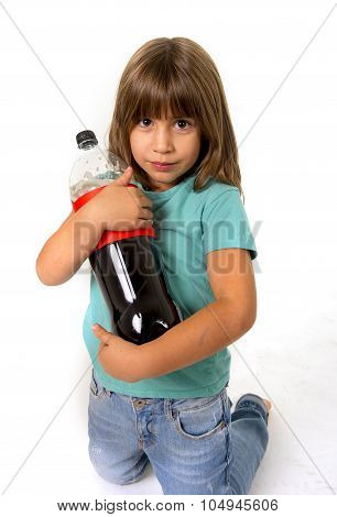 little female child holding big cola soda bottle looking vulnerable in children sugar addiction and bad habit nutrition concept isolated on white background poster