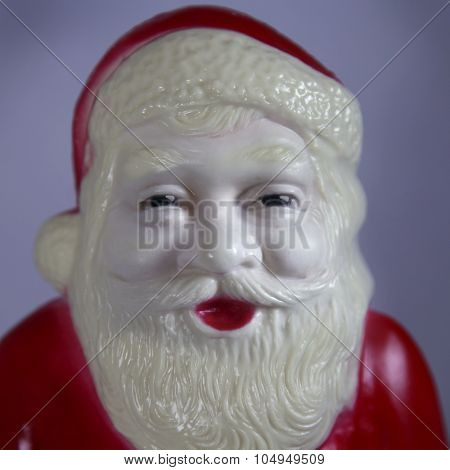 Close up of a vintage plastic Santa Claus Christmas decoration - Instagram filtered