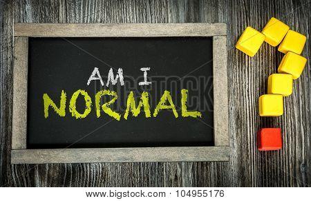 Am I Normal? written on chalkboard poster